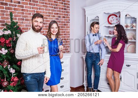 Two Beautiful Couple Communicating On The Party And Have Fun.