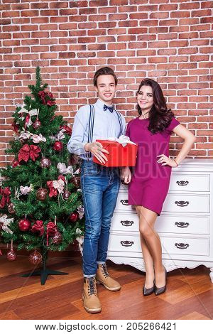 Happiness Young Adult Couple Is Celebrating Christmas At Home.