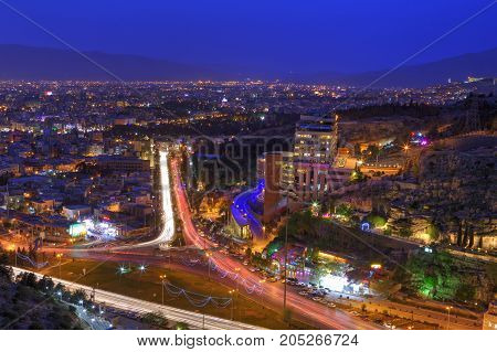 Fars Province Shiraz Iran - 18 april 2017: Panorama of the night city traffic at nightfall.