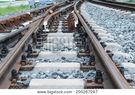 Rails and concrete sleepers. Fork railway. Rail shooter. Between the sleepers and the rails lies the rubble or stones. Branching and the choice of the road.