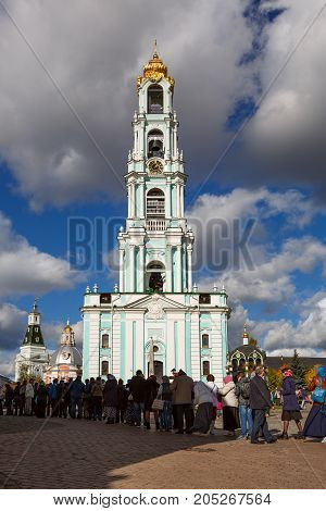 SERGIYEV POSAD/ RUSSIA - OCTOBER 1, 2016. People waiting in a line to see the holy relics in the Trinity Lavra of St. Sergius in front of the large Bell Tower. Sergiyev Posad, Moscow region, Russia