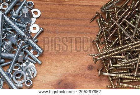 Pile of bolts and srews on wooden workshop