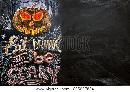 chalkboard with colored crayons at a Halloween banquet