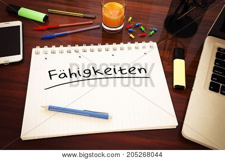 Faehigkeiten - german word for skills - handwritten text in a notebook on a desk
