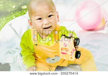 a baby on the mat playing with toys