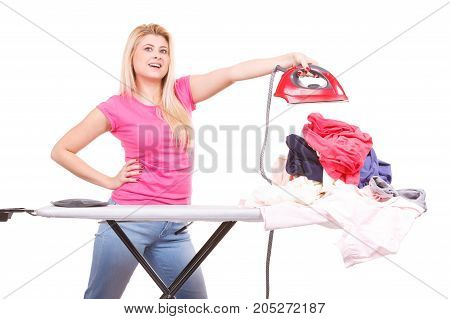 Woman Holding Iron About To Do Ironing