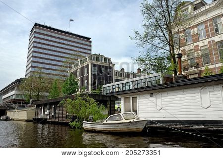 AMSTERDAM NETHERLANDS - MAY 13 2017: Houseboat on the canal in the Amsterdam