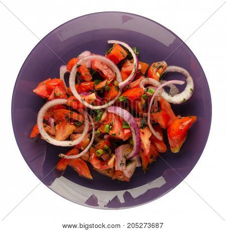 salad of tomatoes, onion, dill on a plate isolated on white background. vegetarian food. healthy food