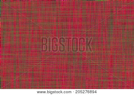 Vibrant rich red and green background with fine plaid pattern fabric look. Christmas holiday or craft texture