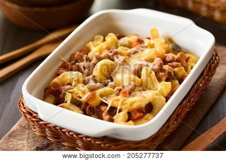 Chili con carne and macaroni pasta casserole in baking dish photographed with natural light (Selective Focus Focus one third into the dish)
