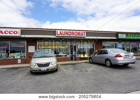 JOLIET, ILLINOIS / UNITED STATES - JULY 24, 2017:  One may wash one's clothes at Muddy's Laundromat, in a strip mall on Plainfield Road.