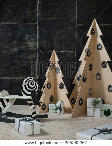 New Year's and Christmas decoration zebra and fir plywood and wood on a dark background