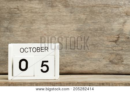 White block calendar present date 5 and month October on wood background (World teacher day)