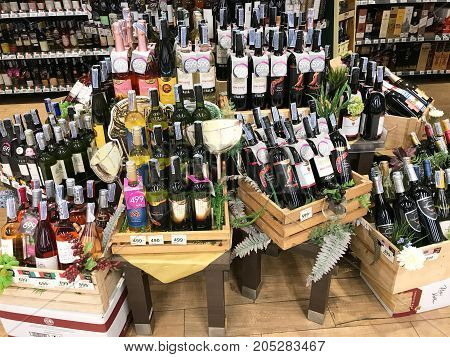 Bangkok Thailand - SEP 23, 2017: group fo wine bottles at food supermarket