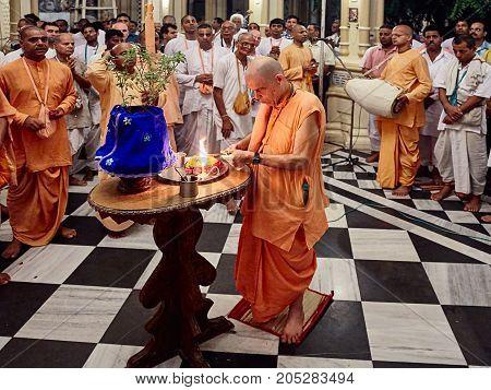 Hindu Priest Doing Tulasi Puja During The Morning Darshan Inside The Sri Krishna Balaram Mandir, Isk