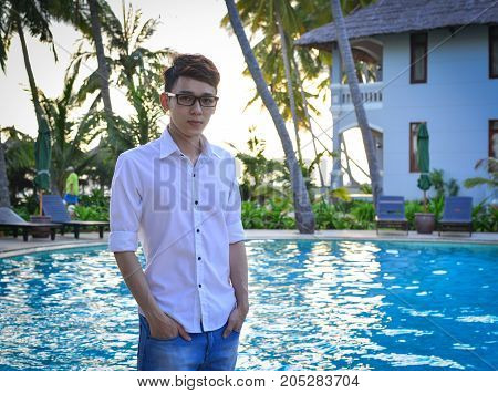 An Asian Young Man At Swimming Pool