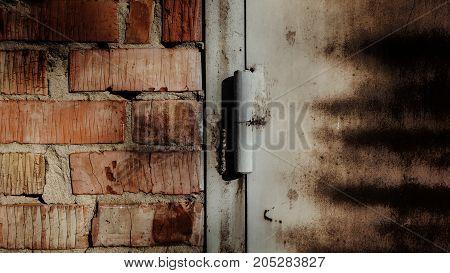 Grunge. Fragment of brick walls and iron doors. Grunge background. Grunge brick background. Grunge door.