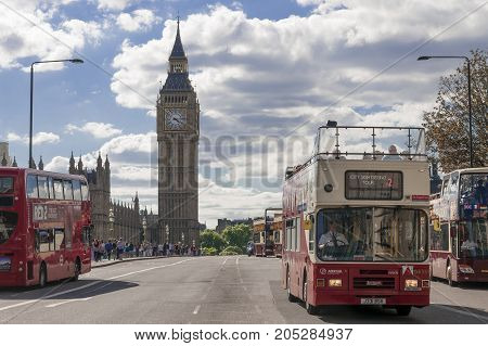LONDON UK - AUGUST 11 2013; Buses cross Westminster Bridge in London on a sunny afternoon.