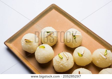 Stock Photo of Rasgulla or sponge Ras Gulla, It is made from ball shaped dumplings of chhena and semolina dough, cooked in light syrup made of sugar.