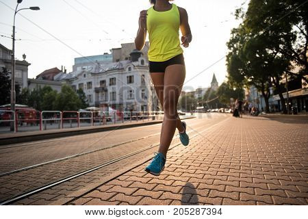 Jogger woman training herself by running outdoors