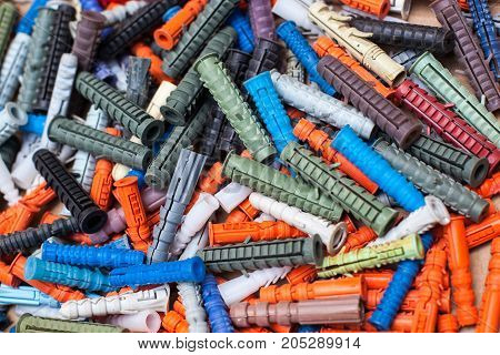 large number of multicolored dowels close-up background