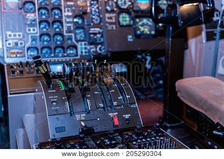 A view of the cockpit of a large commercial airplane a cockpit trainer. Cockpit view of a commercial jaircraft cruising Control panel in a plane cockpit