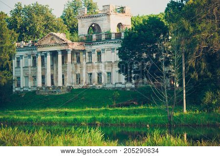 beautiful Grand old estate on the banks of the river in the forest that needs restoration