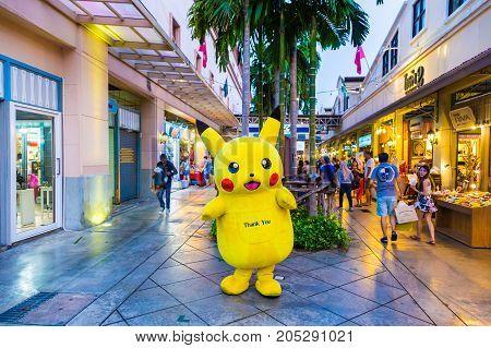 Bangkok Thailand - 13 September 2017 - Pokemon Pikachu mascot stands greeting customers at Asiatique Bangkok Thailand on an evenging of September 13 2017