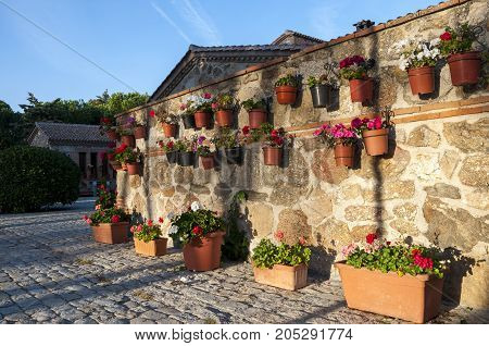 Flower pots hanged of the wall. Photo taken in hermitage of Our Lady of Remedies (Nuestra Señora de los Remedios) Colmenar Viejo, Madrid, Spain.