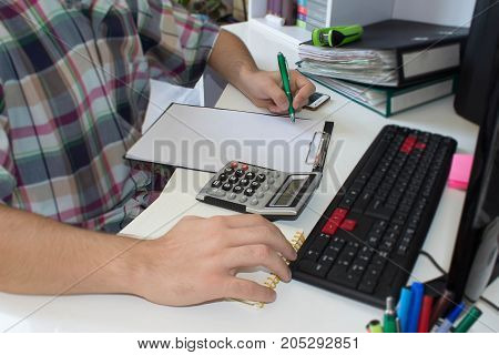 Businessman financial inspector discussing financial graph data on office table. Man hand with calculator at workplace office