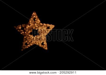beautiful shiny gold Christmas star on a black background