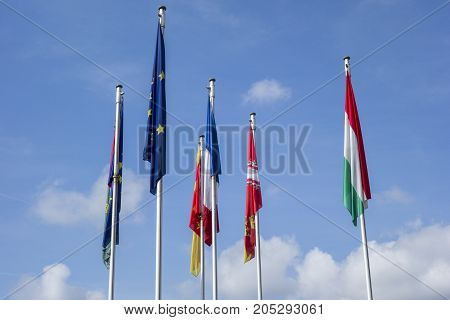 Flags of the European Union hanging from the mast