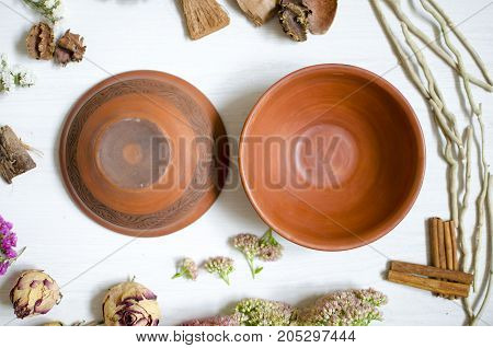 Ceramic Decorative Plates. Clay Dishes On The White Wooden Table