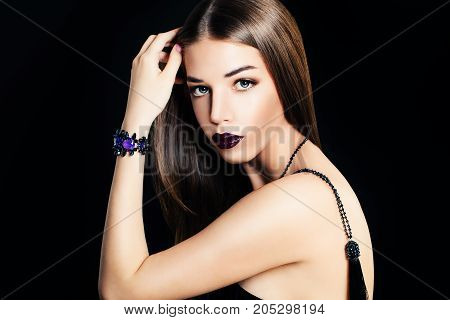 Glamorous Woman Fashion Model with Makeupand Long Hair on Black Banner Background