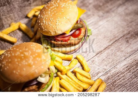Fresh Delicious tasty burgers on wooden background. Fast and tasty food