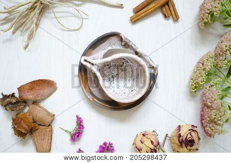 Decorative Pottery. Ceramics Coffee Cup On The White Wooden Bacground With Dried Flowers And Cinnamo