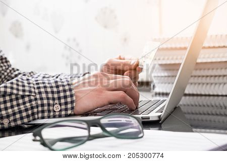 Hands With Plastic Card And Laptop