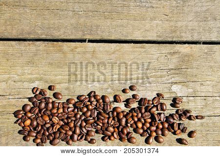 Coffee beans on the rustic wooden background