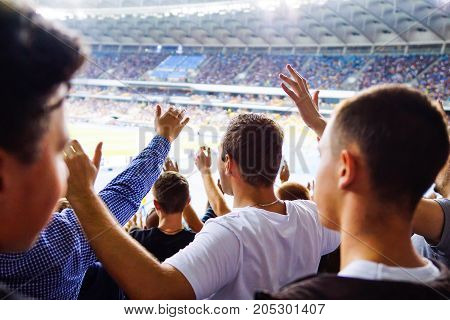 Football- Soccer Fans Support Their Team And Celebrate Goal In Full Stadium With Open Air With Nice