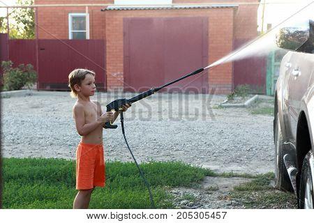 Child Washing Car
