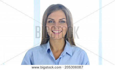 Portrait Of Beautiful Smiling Woman Looking At Camera In Office