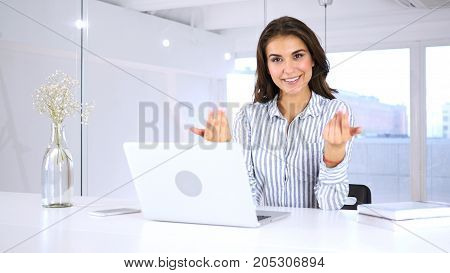 Woman In Office Inviting Customers With Both Hands