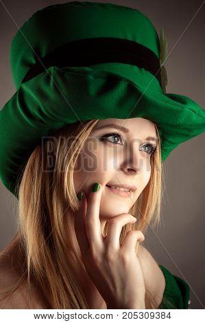portrait charming blond girl in leprechaun hat closeup