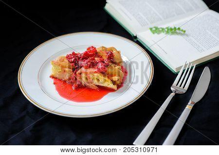 Fruit Pie With Raspberry Jam On A Dark Background