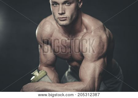 Handsome Model Young Man Takes Sports Nutrition
