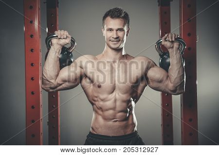 Handsome Young Man Working Out In Gym Kettlebell..