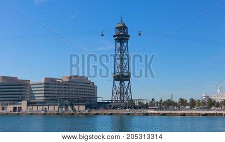 The port of Barcelona at the end of the Ramblas. In the photo the World trade center building and cable way tower in port of Barcelona Catalonia Spain
