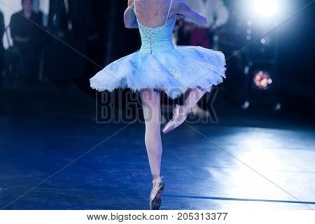 perfection, ballet, strength concept. slender ballerina dressed in insanely beautiful dress with tutu making fouette and all her muscles are tight with tension