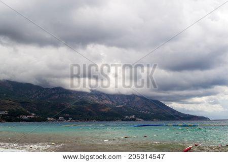 Montenegro beach in rainy weather. The sea and mountains of Montenegro. Budva. Becici