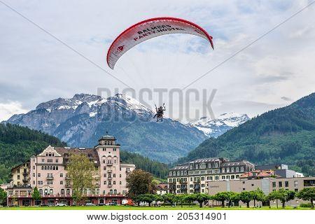Interlaken Switzerland - May 26 2016: Tandem paragliding flights over the Swiss Alps in Interlaken Switzerland.